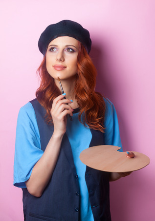 painter girl: Painter girl with brush and palette on pink background. Stock Photo