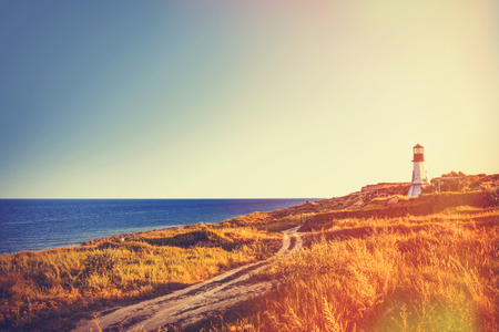 View on old lighthouse near a sea in autumn time 스톡 콘텐츠