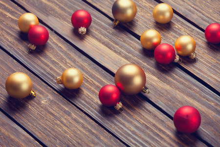 romatic: Cup of coffee and christmas bubbles on wooden background.