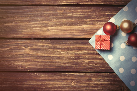 christmas bubbles: Christmas bubbles and gift box on wooden table.