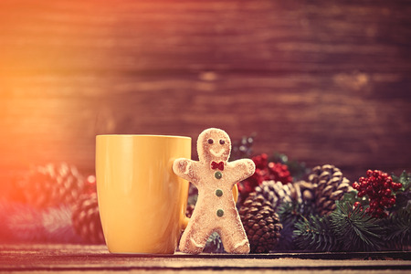 gingerbread man: Gingerbread man near cup and Pine branch Stock Photo