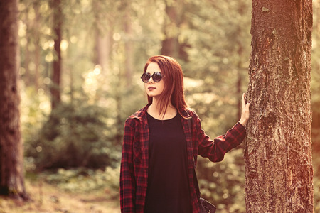 forest wood: Portrait of a redhead women in the forest