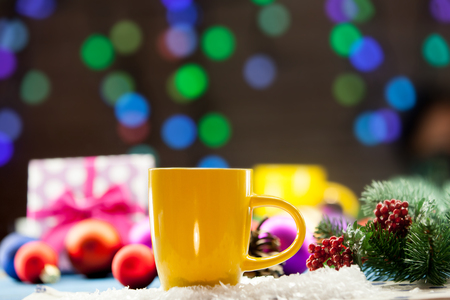 christmas drink: Cup of tea and gifts with Christmas lights on background.