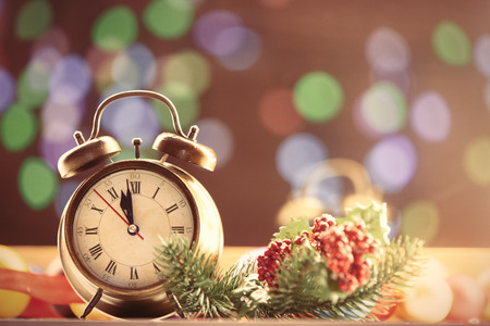 time of the year: Clock and Christmas lights on background