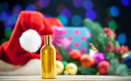 christmas perfume: perfume bottle on Christmas lights background.