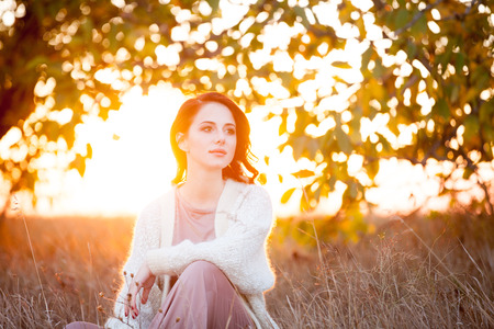 blazer: Woman in white blazer in autumn time outdoor