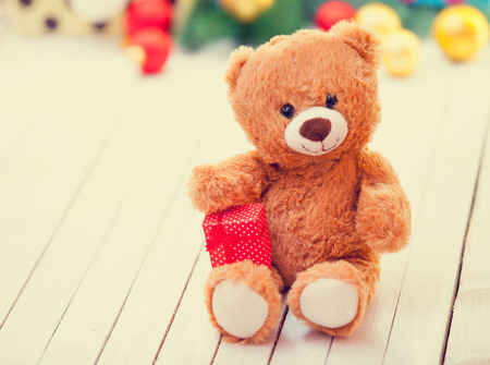 teddy bear: Teddy bear with present on chrismtas gifts background