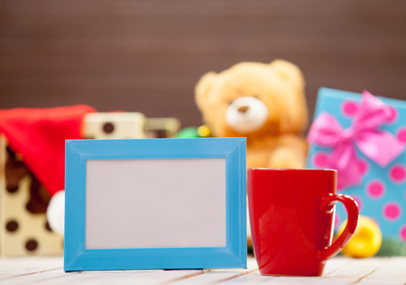 morning coffee: Cup of coffee or tea with blue photo frame on christmas background