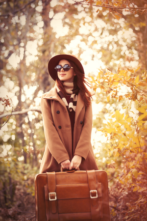 fashion girl style: Woman with bag in autumn park Stock Photo
