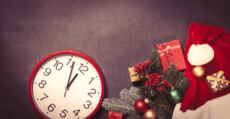 time clock: Vintage clock and christmas gifts on grey background