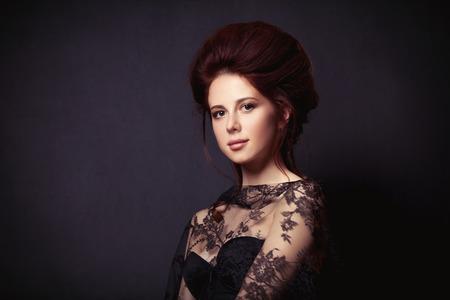 person woman: Portrait of a beautiful woman in style dress on dark backgorund
