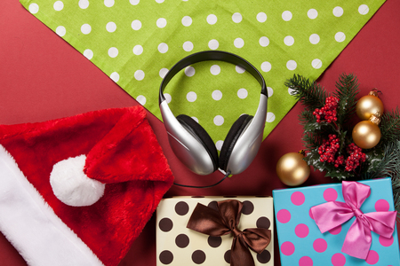 headphones: headphones and christmas gifts on red background Stock Photo
