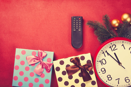 vintage television: TV remote and christmas gifts on red background Stock Photo
