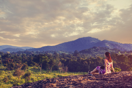 Young woman looking on a mountain landscape