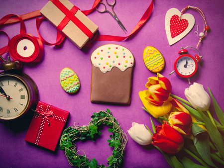 easter cookie: Easter eggs cookie and flowers with others on violet background