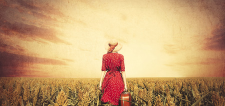 redhead girl: Redhead girl with suitcase at corn field.