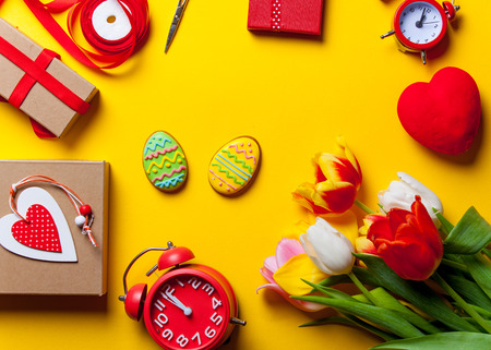easter cookie: Easter eggs cookie and flowers with others on yellow background