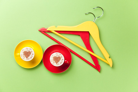 hangers: two hangers and two cups lying on the green table