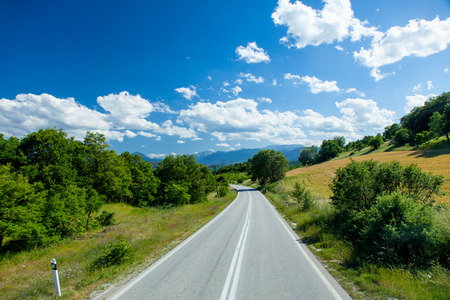 county side: photo of the county side road in Greece on the sky background