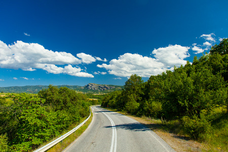 side of the road: photo of the country side road in Greece Stock Photo