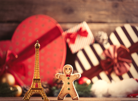 boxing day: photo of the eiffel tower shaped toy and gingerbread man on the christmas decorations background