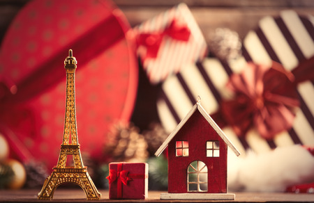 photo of the eiffel tower and house shaped toys on the christmas decorations background Stock Photo