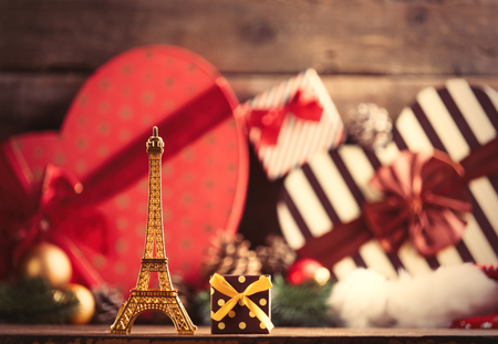 boxing day: photo of the eiffel tower shaped toy and gift on the christmas decorations background Stock Photo