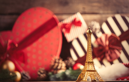 photo of the eiffel tower shaped toy on the christmas decorations background