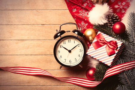 boxing day: photo of the alarm clock  and christmas decorations on the brown wooden background