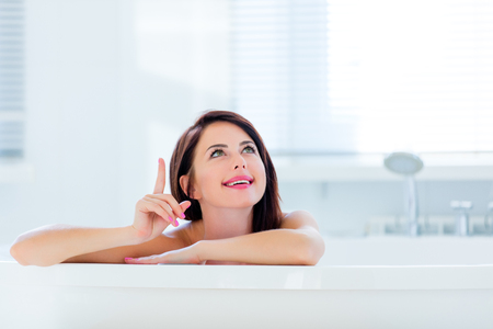woman in bath: photo of the beautiful young woman having a bath