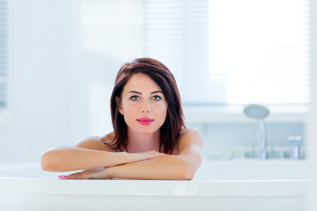 woman in bath: portrait of the beautiful young woman having a bath Stock Photo