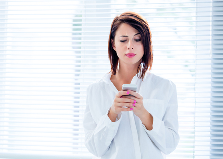 photo of the beautiful young woman using her mobile phone Stock Photo