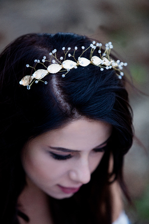 Portrait of a beautiful brunette woman with wreath in autumn outdoor Stock Photo