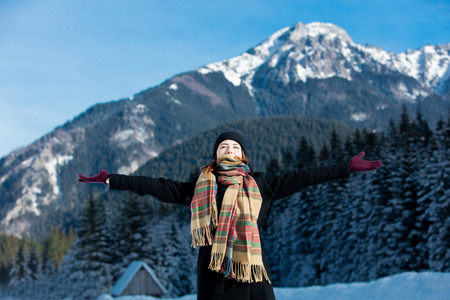 in low spirits: Portrait of a young redhead woman with mountains on background Stock Photo