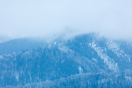 in low spirits: View on winter mountains Tatry, Poland
