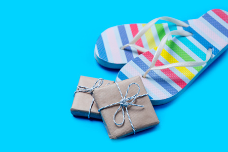 colorful sandals and cute gifts on the wonderful blue background Stock Photo