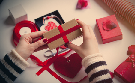 white caucasian hands wrapping gift on the wonderful things for decoration background Stock Photo