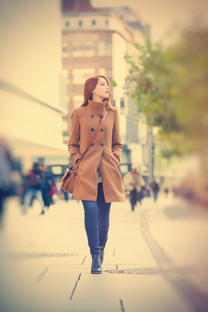 photo of beautiful young woman on one of the streets exploring the town