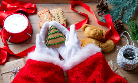 Santa claus have wrapping a christmas cookie and other gifts