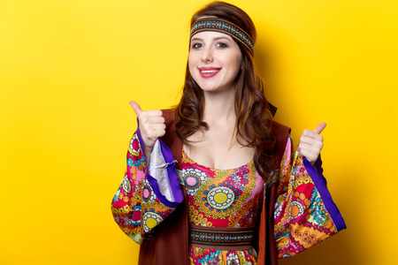 Portrait of Young hippie girl on yellow background