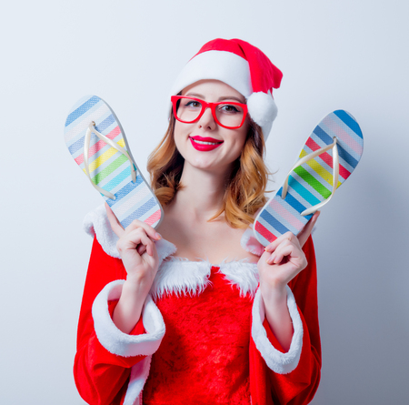 Portrait of Young Santa Clous girl with eyeglasses and Sandales on white background