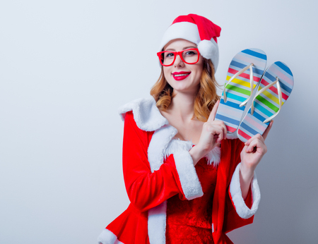 Portrait of Young Santa Clous girl with eyeglasses and Sandales on white background Stok Fotoğraf - 81274206