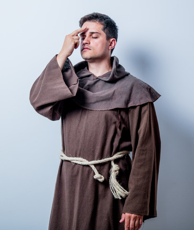 Portrait of Young catholic monk on white background photo