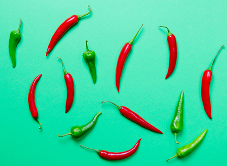 capsaicin: Above view at Chili pepper on green background