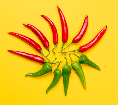 capsaicin: Above view at Chili pepper on yellow background Stock Photo