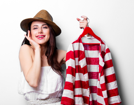 hangers: portrait of the beautiful young woman with jacket on the hanger