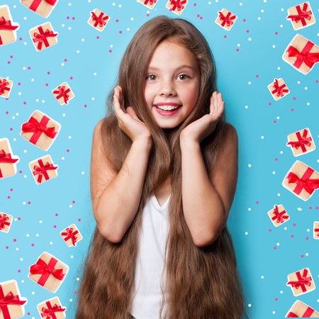 Young smiling girl on blue background. photo