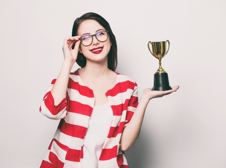 portrait of the beautiful young smiling woman with cup trophy Stock Photo