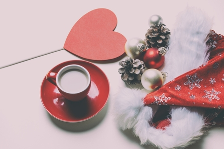 boxing day: photo of the beautiful Christmas decorations, red cup of coffee and heart shaped toy Stock Photo