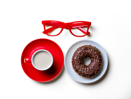 photo of the chocolate donut on the plate, glasses and cup of coffee